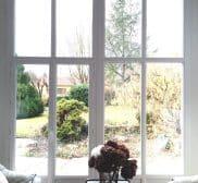 Porte-fenêtre PVC réalisée par votre spécialiste des menuiseries alu et PVC sur Lyon : Isolation Confort