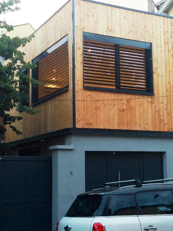 Réalisation fenêtre en aluminium noir et porte de garage